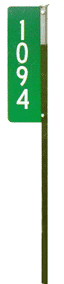 Photograph of a 911 sign on a metal T post.